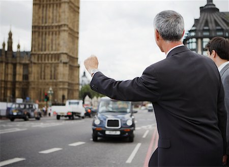 Businessman Hailing Taxi, London, England Stock Photo - Rights-Managed, Code: 700-01248666
