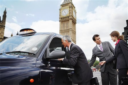 Businesspeople Getting in Taxi, London, England Stock Photo - Rights-Managed, Code: 700-01248667