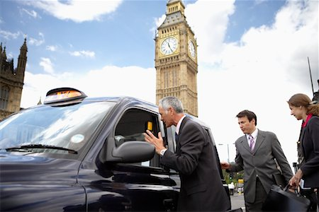 Businesspeople Getting in Taxi, London, England Stock Photo - Rights-Managed, Code: 700-01248668