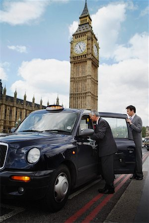 Businesspeople Getting in Taxi, London, England Stock Photo - Rights-Managed, Code: 700-01248669