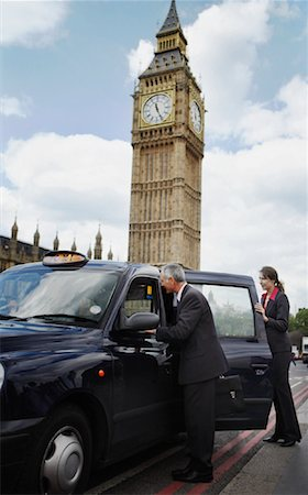 Businesspeople Getting in Taxi, London, England Stock Photo - Rights-Managed, Code: 700-01248670