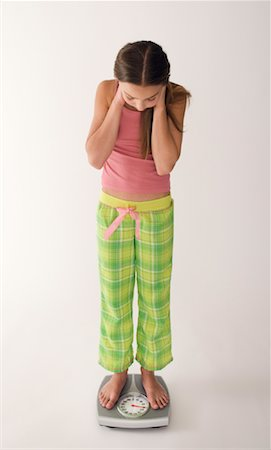 preteen girl feet - Girl Standing on Scale Stock Photo - Rights-Managed, Code: 700-01248704