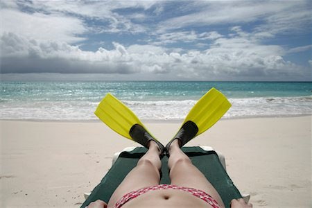 Woman Wearing Flippers, Lying on the Beach Stock Photo - Rights-Managed, Code: 700-01249073