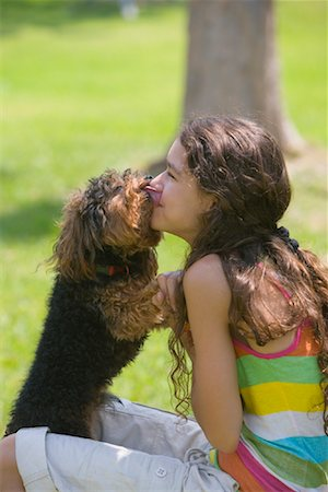 dog kissing girl - Girl with Dog Stock Photo - Rights-Managed, Code: 700-01275759
