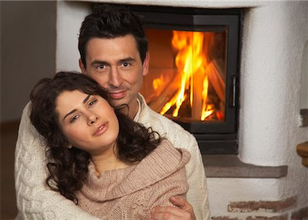 sweater and fireplace - Couple by Fireplace Stock Photo - Rights-Managed, Code: 700-01275908