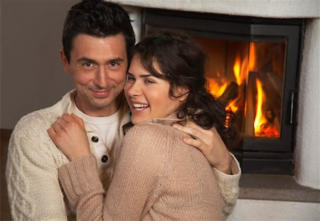 sweater and fireplace - Couple by Fireplace Stock Photo - Rights-Managed, Code: 700-01275909