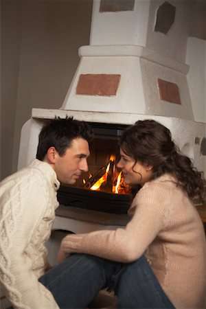 sweater and fireplace - Couple by Fireplace Stock Photo - Rights-Managed, Code: 700-01275910