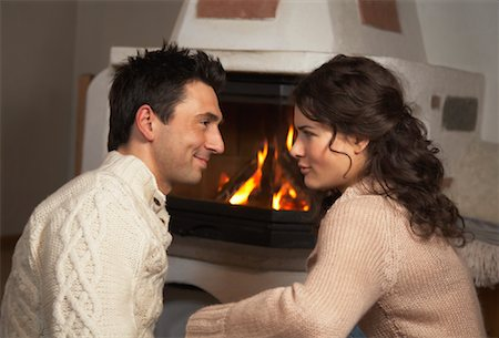 sweater and fireplace - Couple by Fireplace Stock Photo - Rights-Managed, Code: 700-01275911