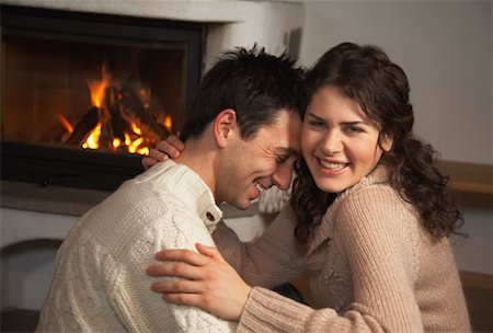 sweater and fireplace - Couple by Fireplace Stock Photo - Rights-Managed, Code: 700-01275913