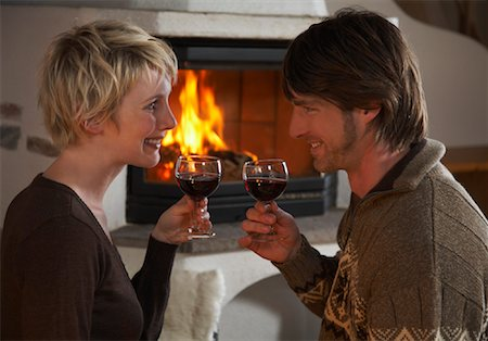sweater and fireplace - Couple Drinking Wine Stock Photo - Rights-Managed, Code: 700-01275924