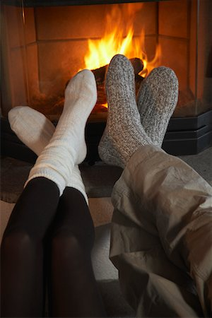 Couple's Feet by Fireplace Stock Photo - Rights-Managed, Code: 700-01275928