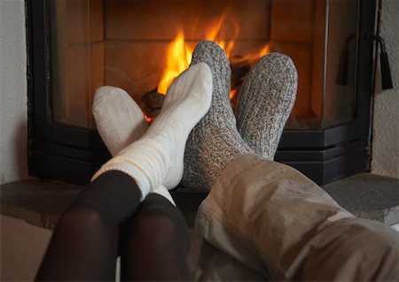 Couple's Feet by Fireplace Stock Photo - Rights-Managed, Code: 700-01275929