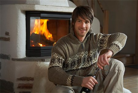 sweater and fireplace - Man Sitting by Fireplace Stock Photo - Rights-Managed, Code: 700-01275921