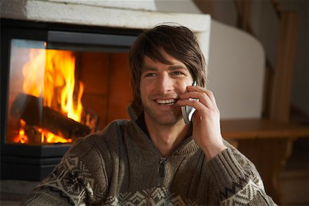 sweater and fireplace - Man Using Cell Phone Stock Photo - Rights-Managed, Code: 700-01275922