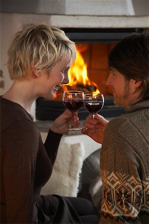 sweater and fireplace - Couple Drinking Wine Stock Photo - Rights-Managed, Code: 700-01275923