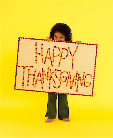 Little Girl Holding Thanksgiving Sign Stock Photo - Rights-Managed, Code: 700-01275940