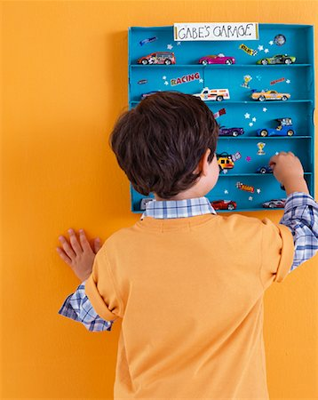 Boy Putting Away His Toys Stock Photo - Rights-Managed, Code: 700-01275942