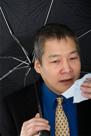 Businessman Sneezing Stock Photo - Rights-Managed, Code: 700-01276267
