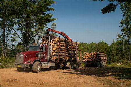 Loaded Logging Truck Driving Away Stock Photo - Rights-Managed, Code: 700-01295619