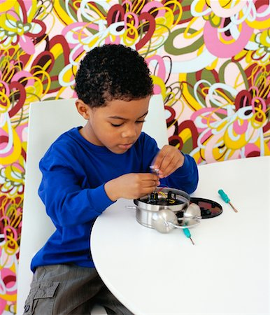 Boy Fixing Alarm Clock Stock Photo - Rights-Managed, Code: 700-01295917