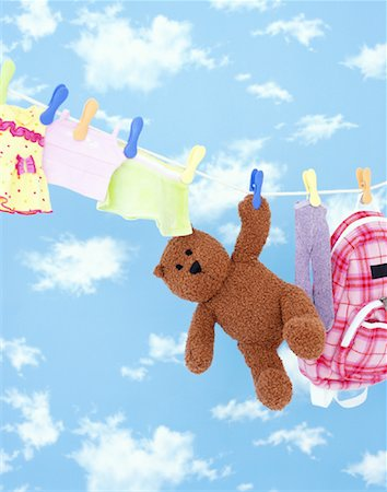 Child's Items on Clothes Line Stock Photo - Rights-Managed, Code: 700-01295911