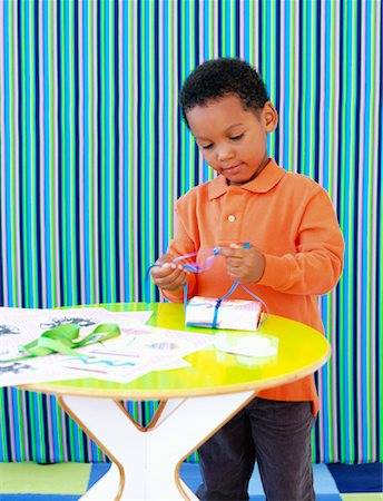Boy Wrapping Present Stock Photo - Rights-Managed, Code: 700-01295913
