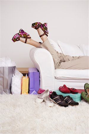 Woman on Sofa with Shoes Stock Photo - Rights-Managed, Code: 700-01344519