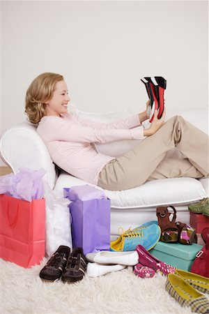 Woman on Sofa with Shoes Stock Photo - Rights-Managed, Code: 700-01344525