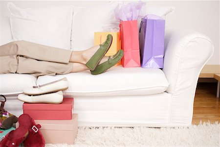 Woman on Sofa with Shoes Stock Photo - Rights-Managed, Code: 700-01344526