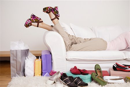 Woman on Sofa with Shoes Stock Photo - Rights-Managed, Code: 700-01344520