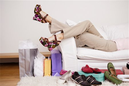Woman on Sofa with Shoes Stock Photo - Rights-Managed, Code: 700-01344521
