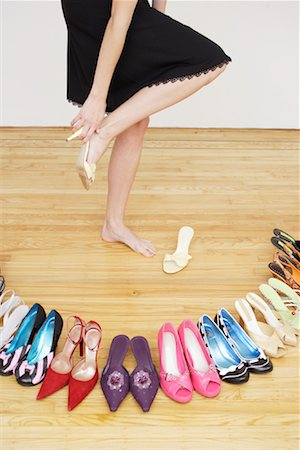 Woman Trying on Shoe Stock Photo - Rights-Managed, Code: 700-01344555