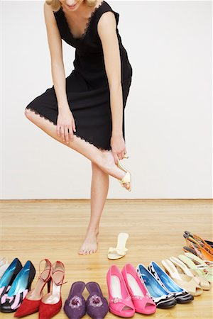 Woman Putting on Shoe Stock Photo - Rights-Managed, Code: 700-01344556