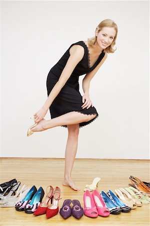 Woman Putting on Shoe Stock Photo - Rights-Managed, Code: 700-01344557