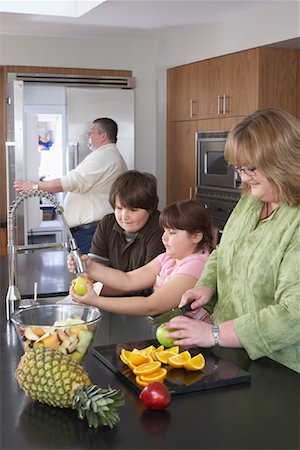 Family Making Fruit Salad Stock Photo - Rights-Managed, Code: 700-01345018