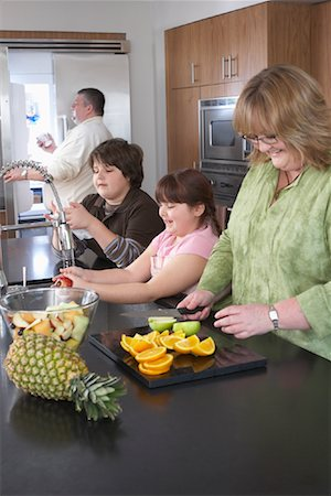 Family Making Fruit Salad Stock Photo - Rights-Managed, Code: 700-01345019