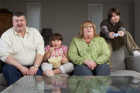 Family Playing Video Game with Popcorn Stock Photo - Rights-Managed, Code: 700-01345026