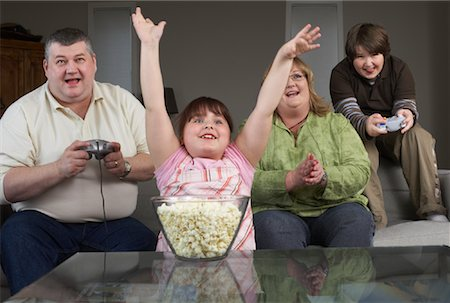 Family Playing Video Game with Popcorn Stock Photo - Rights-Managed, Code: 700-01345027