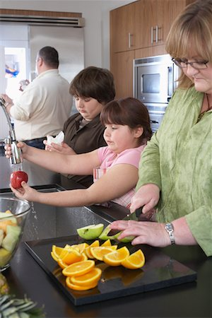Family Making Fruit Salad Stock Photo - Rights-Managed, Code: 700-01345020