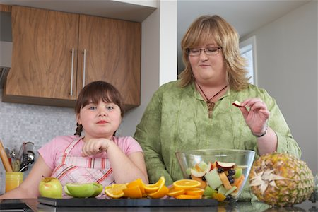 Mother and Daughter Making Fruit Salad Stock Photo - Rights-Managed, Code: 700-01345022
