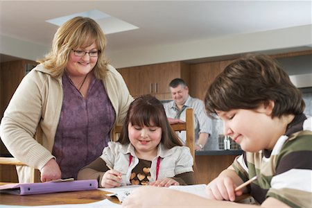Mother Helping Children with Homework Stock Photo - Rights-Managed, Code: 700-01345034