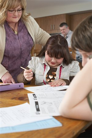 Mother Helping Children with Homework Stock Photo - Rights-Managed, Code: 700-01345033