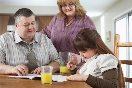 Parents Watching Daughter do Homework Stock Photo - Rights-Managed, Code: 700-01345042