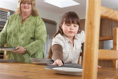 Mother and Daughter Setting Table Stock Photo - Rights-Managed, Code: 700-01345054