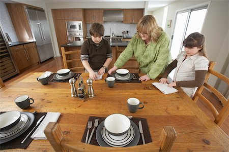 Mother and Children Setting Table Stock Photo - Rights-Managed, Code: 700-01345059