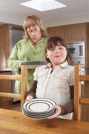 Mother and Daughter Setting Table Stock Photo - Rights-Managed, Code: 700-01345053