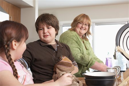 Mother and Children Washing Dishes Stock Photo - Rights-Managed, Code: 700-01345065