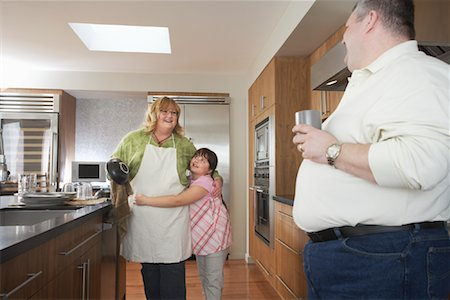 Parents in Kitchen with Daughter Stock Photo - Rights-Managed, Code: 700-01345075