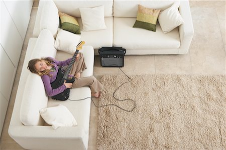preteen  smile  one  alone - Girl Playing Guitar on Sofa Stock Photo - Rights-Managed, Code: 700-01463750