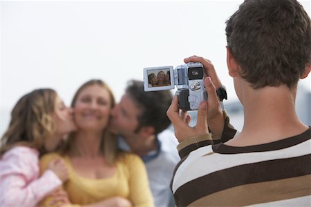 Boy Taking Video of Family Stock Photo - Rights-Managed, Code: 700-01463771